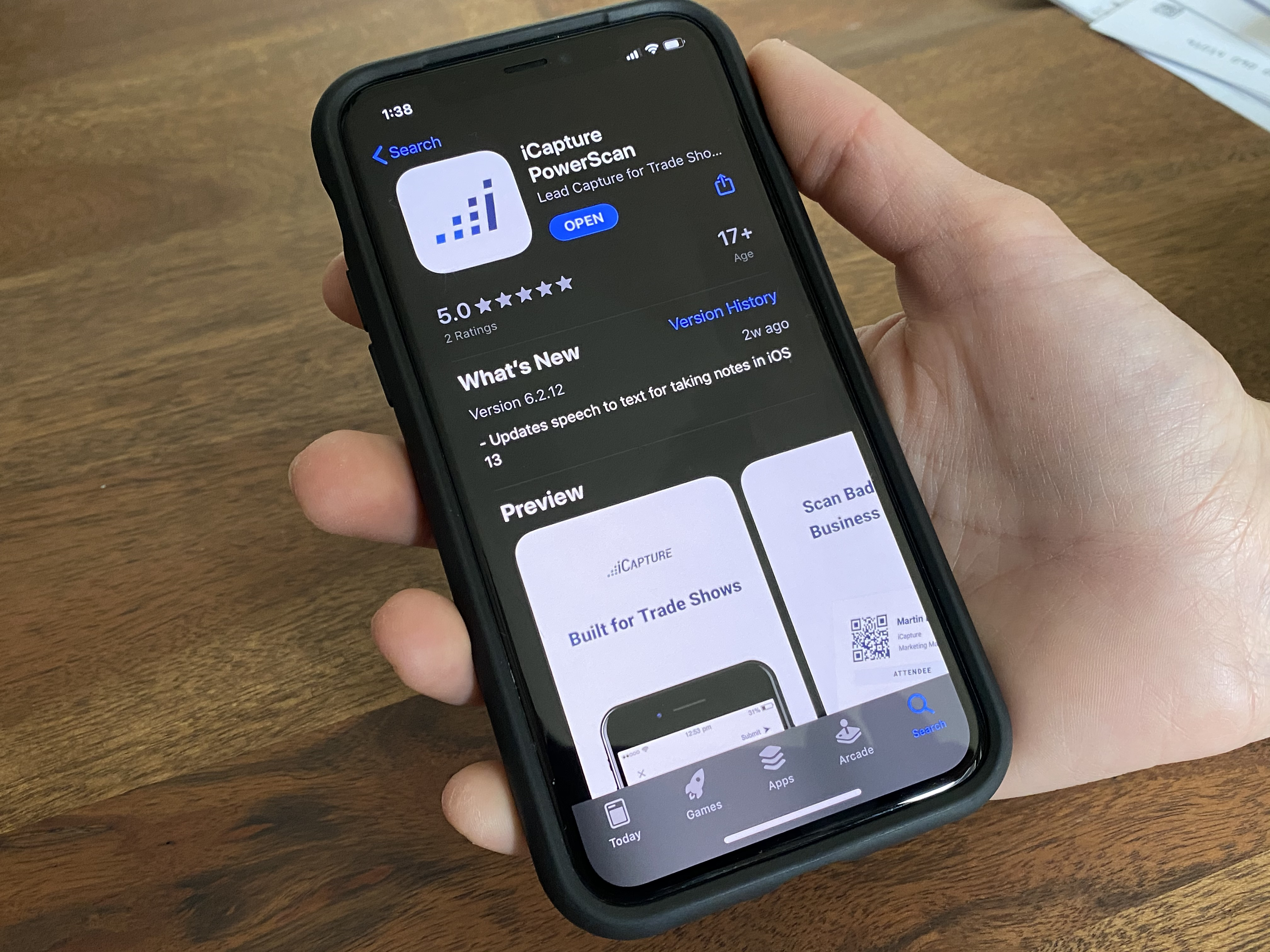 app on phone with hand