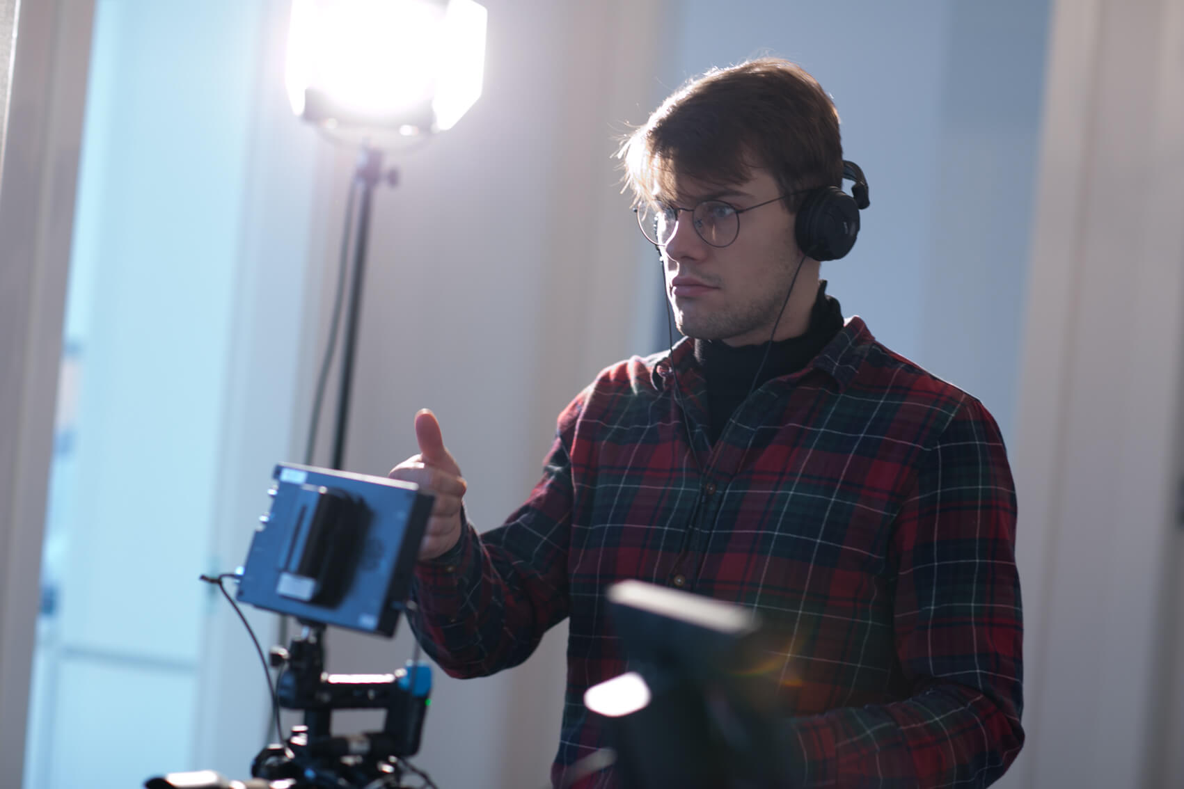 Mateusz on set behind the Camera